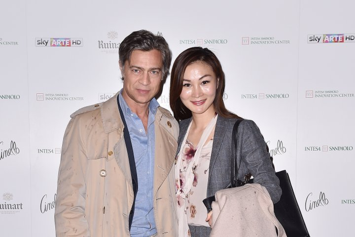 MILAN, ITALY - APRIL 11:  Davide Meretti and Chandice Yang attend Save The Artistic Heritage - Vernissage Cocktail on April 11, 2018 in Milan, Italy.